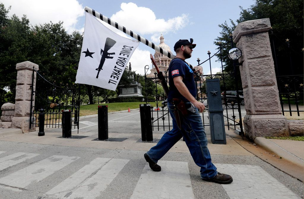 Gun rights advocates gather outside the state Capitol in Austin where Gov. Greg Abbott held a roundtable discussion Aug. 22 in the wake of the mass shooting at an El Paso Walmart. After the Midland-Odessa shooting, the second gun massacre in Texas in less than a month, state officials are now seriously debating more-restrictive gun laws for the first time.