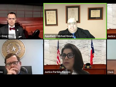 A screengrab of Dallas Fifth District Court of Appeals, Chief Justice Robert Burns, III, bottom left, Justice Robbie Partida-Kipness, bottom center, and Justice Lana Myers, and assistant district attorney Douglas Gladden, top left, all listen to Michael Mowla, top center, Amber Guyger's defense lawyer, as he makes the case to toss her murder conviction for killing Botham Jean in his own apartment. Dallas County prosecutor said the jury's verdict should stand.