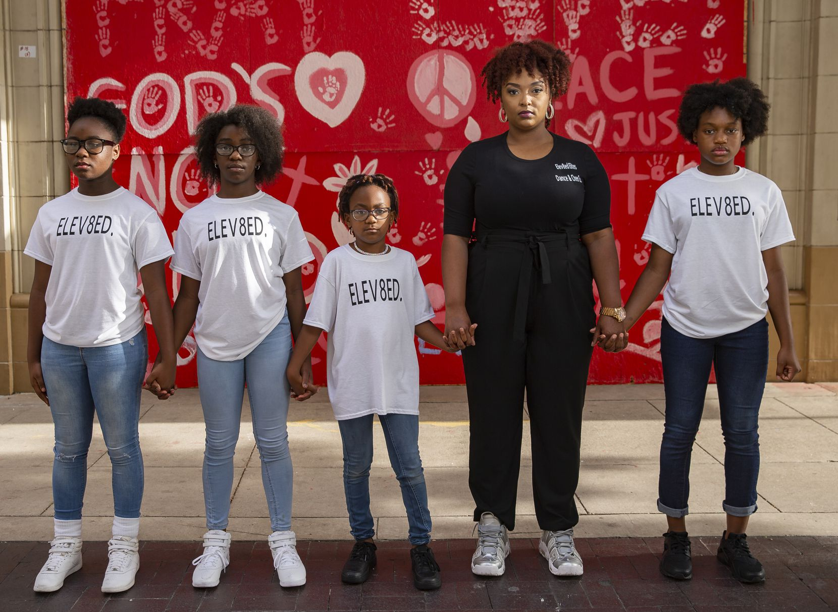 (From left) Members of Elev8ed Elites, Janyiah Cooks, 12, Zaria Fisher, 10, Arianna Roberts, 7, dance director Shantrail White and co-captain Sha'kyra Roberts, 13, pose for a photo on June 27, 2020 in Dallas. Elev8ed Elites is an all girls dance team that shot a video downtown in response to police brutality shortly after George Floyd died. (Juan Figueroa/ The Dallas Morning News)
