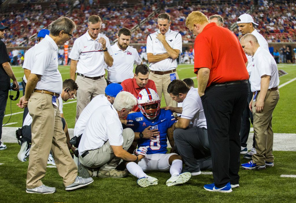 SMU Mustangs wide receiver Reggie Roberson Jr. (8) is looked at after he was hit by Tulsa Golden Hurricane safety Manny Bunch (10) during the third quarter of an NCAA football game between Tulsa and SMU on Saturday, October 5, 2019 at Ford Stadium on the SMU campus in Dallas. (Ashley Landis/The Dallas Morning News)
