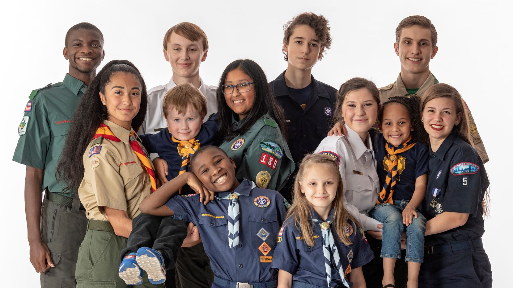 A group of young people from the Boy Scouts of America pose together for a group photo.
