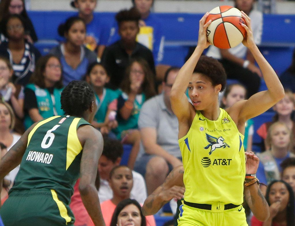 Dallas Wings forward Isabelle Harrison (20) pulls down a defensive rebound as Seattle Storm forward Natasha Howard (6) looks on during second quarter action. The two teams played their WNBA game at College Park Center in Arlington on September 8, 2019.
