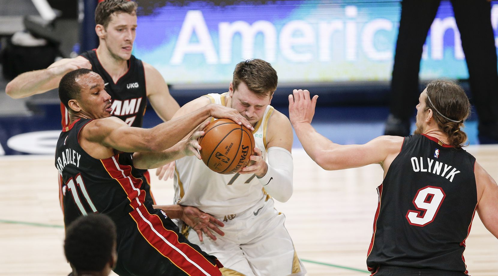Dallas Mavericks guard Luka Doncic, center, battles Miami Heat guards Avery Bradley (11), Goran Dragic (7) and forward Kelly Olynyk (9) for space during the second half of an NBA basketball game, Friday, January 1, 2021.  Dallas won 93-83. (Brandon Wade/Special Contributor)