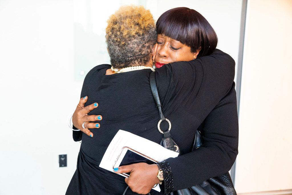 Tonnie Washington, facing camera, embraces Sherri Rand following ceremonies honoring the class of 1969 at Booker T. Washington High School for the Performing and Visual Arts in Dallas on Sunday, June 2, 2019. Fifty years after desegregation separated classmates at Booker T. Washington Technical High School, the class of 1969 turned its reunion into a belated convocation. Some members of the Class of '69  were unable to graduate from Booker T. Technical High School when a federal desegregation order dispersed them to other Dallas high schools. The ceremony also honored students who would have graduated in 1970 had officials not closed the school.