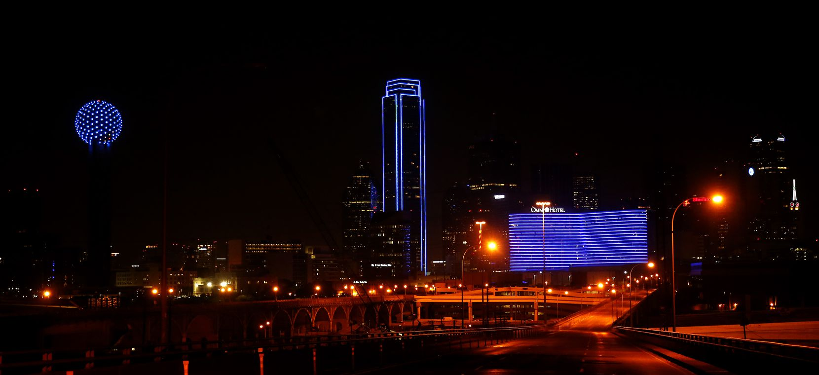 Usually outlined in green lights, the Bank of America Plaza switched to blue to honor law enforcement officers.
