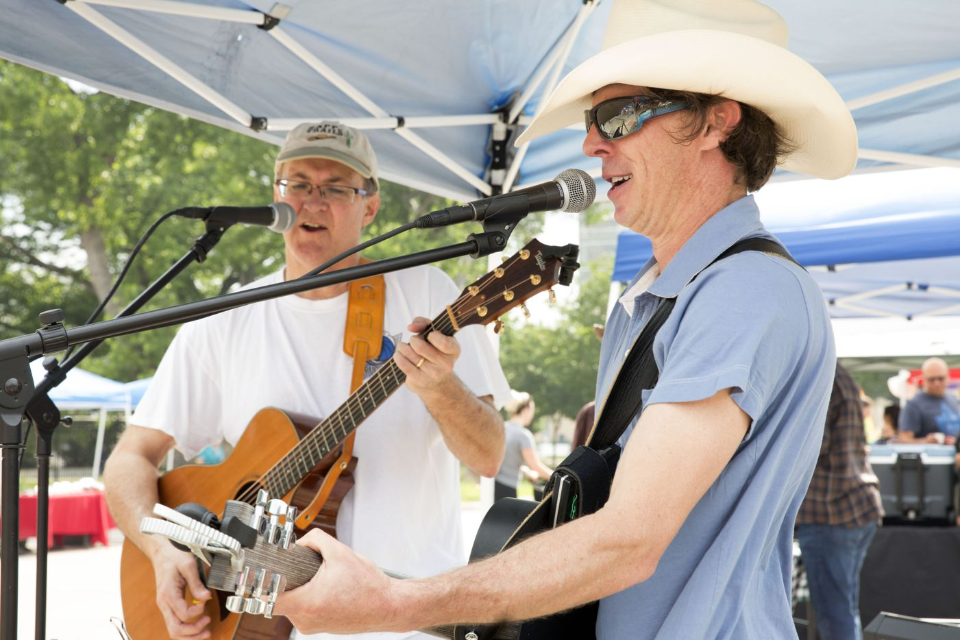 Discovery Mass Band members Mike Ernst (left) and Mark McCommas (right) perform at the opening day  of Saint Michael's Farmers Market.