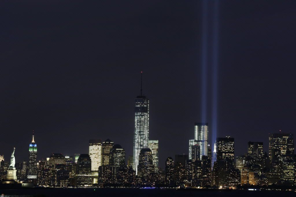 The Tribute in Light rises above the lower Manhattan skyline and One World Trade Center, center, in a test of the memorial light display on Sept. 9, 2013 in New York.