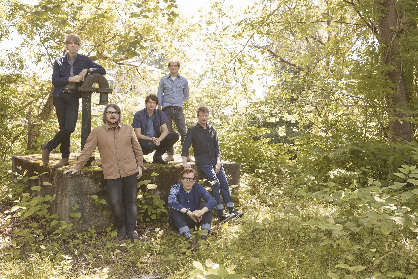 Jeff Tweedy, second from left, poses with members of the band Wilco.