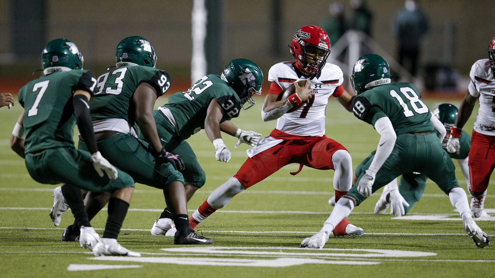 Cedar Hill senior quarterback Kaidon Salter (7) looks for room against a swarm of Waxahachie defenders during Cedar Hill's 35-10 win Friday. (Brandon Wade/Special Contributor)