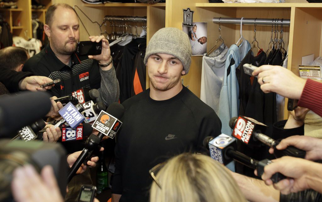 Cleveland Browns quarterback Johnny Manziel talks with the media at the NFL football team's training camp, Monday, Dec. 29, 2014, in Berea, Ohio.