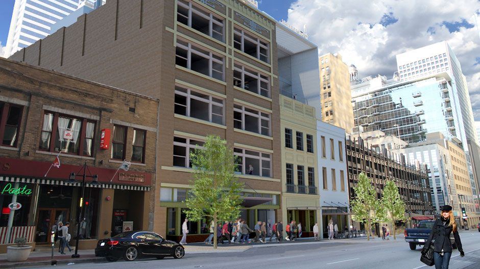 The row of commercial buildings is being redone into apartments and retail.