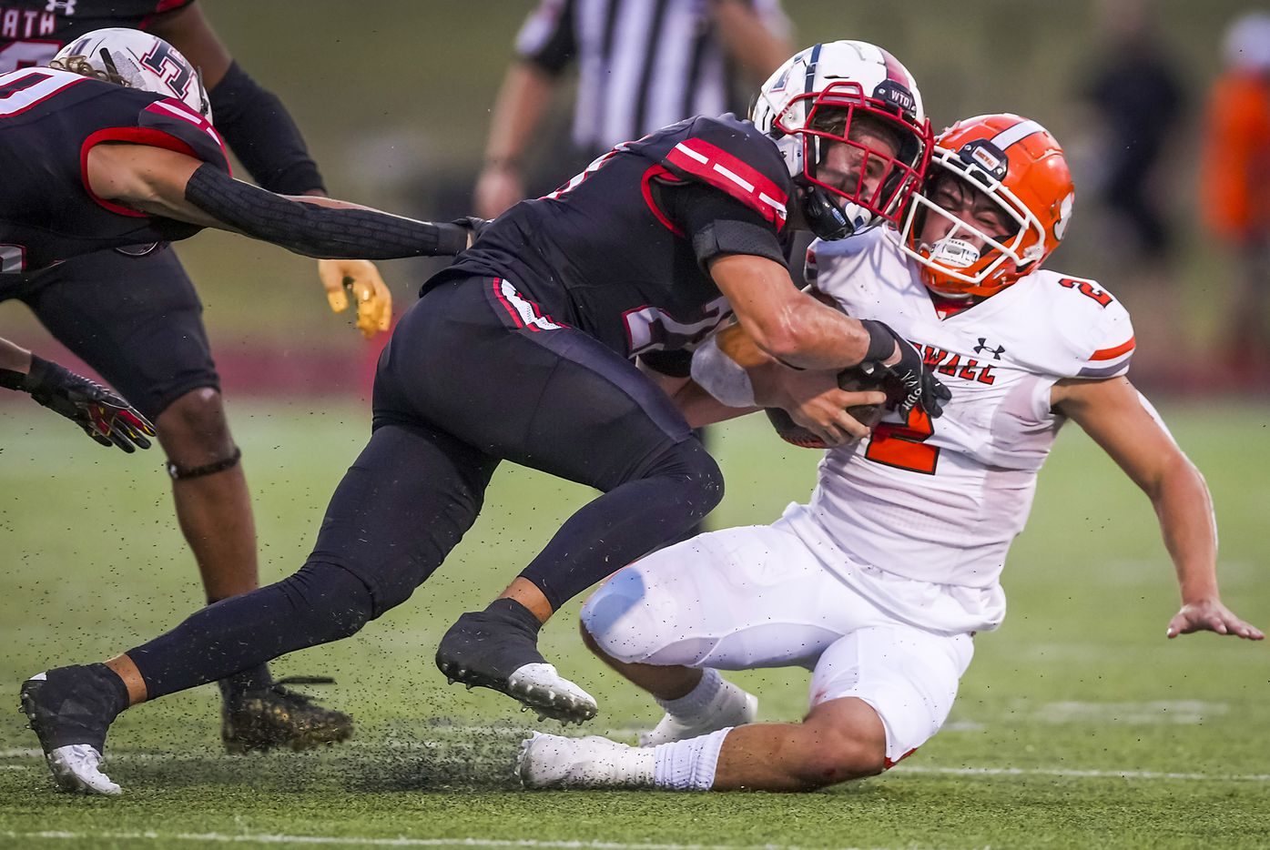 Rockwall running back  Zach Hernandez (2) is brought down by Rockwall-Heath linebacker Noah Wilson (23) during the first half of a District 10-6A high school football game at Wilkerson-Sanders Stadium on Friday, Sept. 24, 2021, in Rockwall.