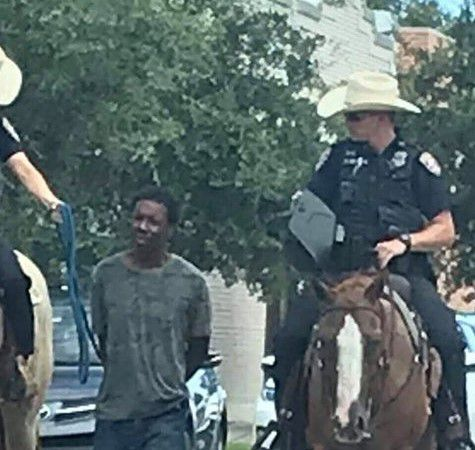 A photo showing a black man being led through Galveston by police officers on horseback has triggered outrage and an apology from the police chief, a former Dallas officer.