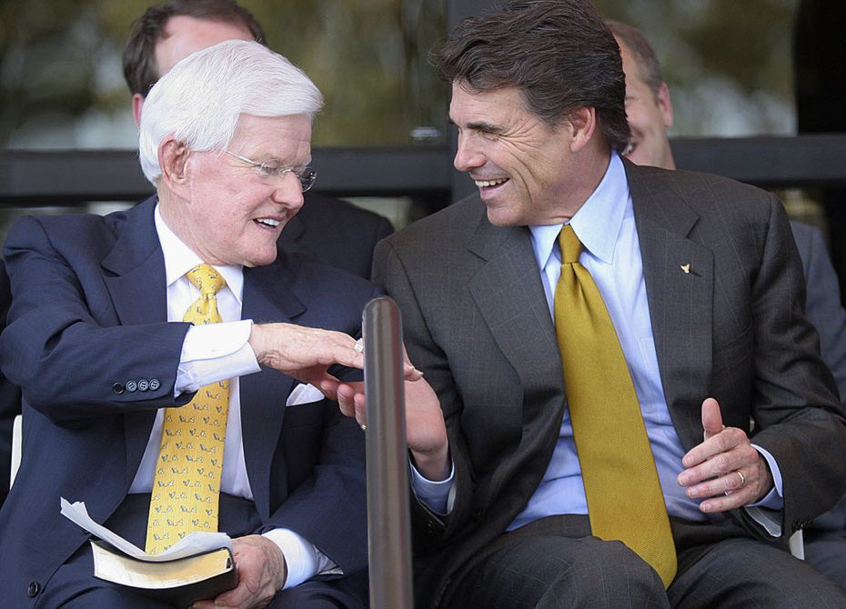 "FILE- In this Sept. 18, 2005, photo, Lonnie ""Bo"" Pilgrim, CEO and Chairman of the Board of Board of Pilgrim's Pride Chicken, left, shakes hands with Texas Gov. Rick Perry at the Dedication Open House of the companies new headquarters in Pittsburg, Texas."
