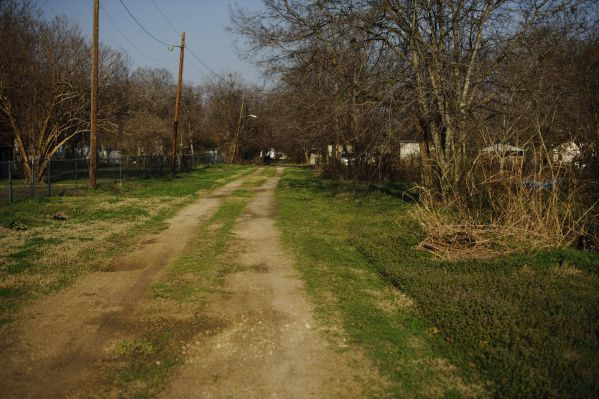 A back alley in Kemp, a rural area of Kaufman County where an isolated Mennonite cabinet maker was scammed out of $1 million of his savings by two men who tricked him into thinking they belonged to a secret and powerful group called the Illuminati.