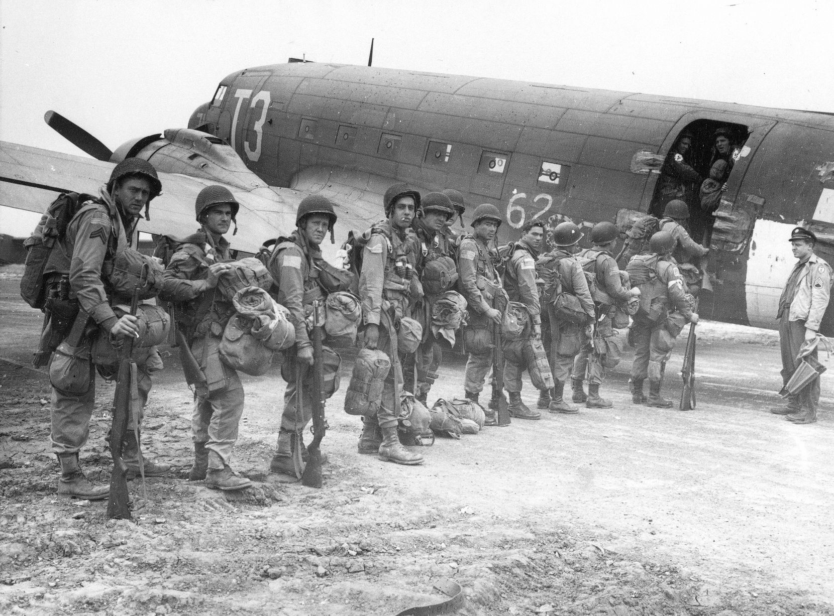 """Allied paratroopers enter a transport plane before taking off on the assault on German-occupied Holland during """"Operation Market Garden""""  Sept. 17, 1944."""