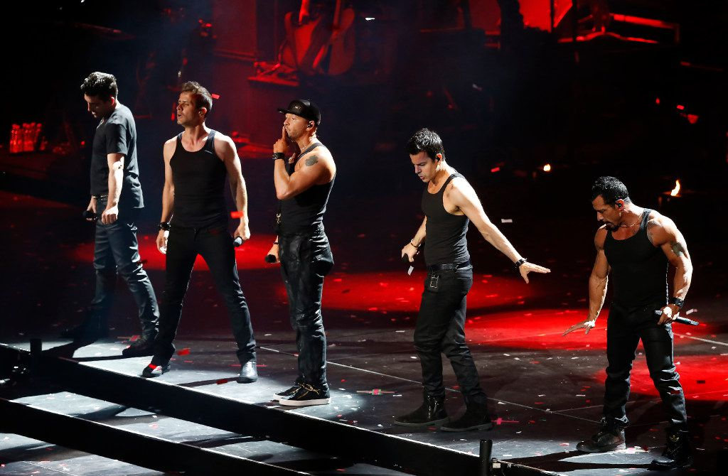 Members of New Kids On The Block Donnie Wahlberg, Joey McIntyre, Danny Wood, Jordan Knight and Jonathan Knight perform during the Total Package Tour at American Airlines Center in Dallas, May 23, 2017.