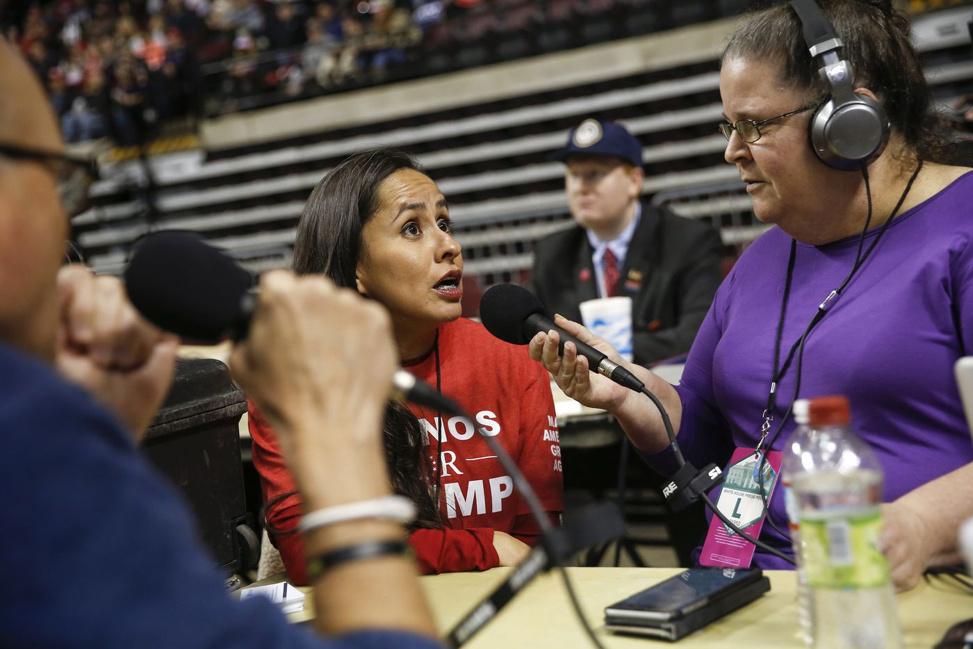 Martha Doss gives an interview to Robert J Wright and Erin McCarty of KEEL 710 AM radio during a rally to reelect President Donald Trump in Bossier City, La.