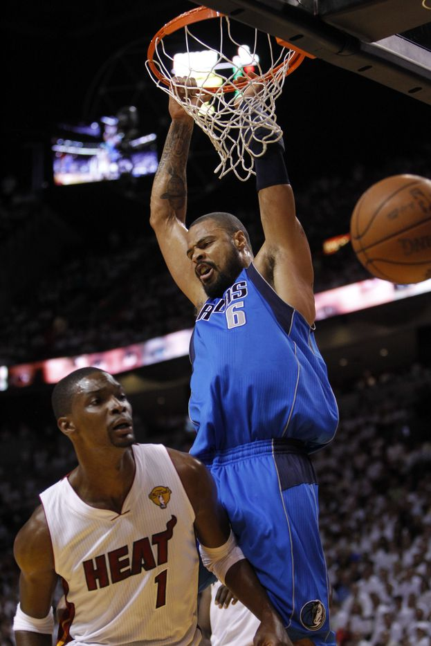 Dallas Mavericks center Tyson Chandler (6) dunks on Miami Heat power forward Chris Bosh (1) in the first quarter of game six of the NBA Finals between the Miami Heat and the Dallas Mavericks at the American Airlines Arena in Miami, Florida, June 12, 2011. (Tom Fox/The Dallas Morning News) 06132011xSPORTS 12102011xBRIEFING