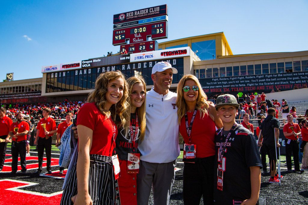 LUBBOCK, TEXAS - OCTOBER 05: Head coach Matt Wells of the Texas Tech Red Raiders poses with his family after the victory against the Oklahoma State Cowboys on October 05, 2019 at Jones AT&T Stadium in Lubbock, Texas. (Photo by John E. Moore III/Getty Images)