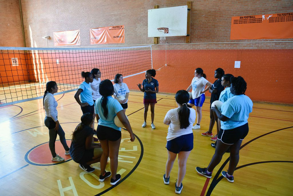 Roosevelt coach Alexandria Jackson (center) speaks with her players at the start of workouts at Oliver W. Holmes Academy in Dallas. (Ben Torres/Special Contributor)