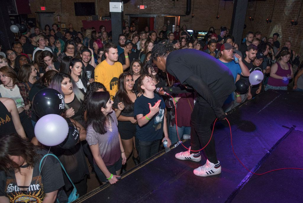 Emo Nite DJs like Jay Webster engage with the crowd, often inviting people to sing along and dance onstage. (Rex C. Curry/Special Contributor)