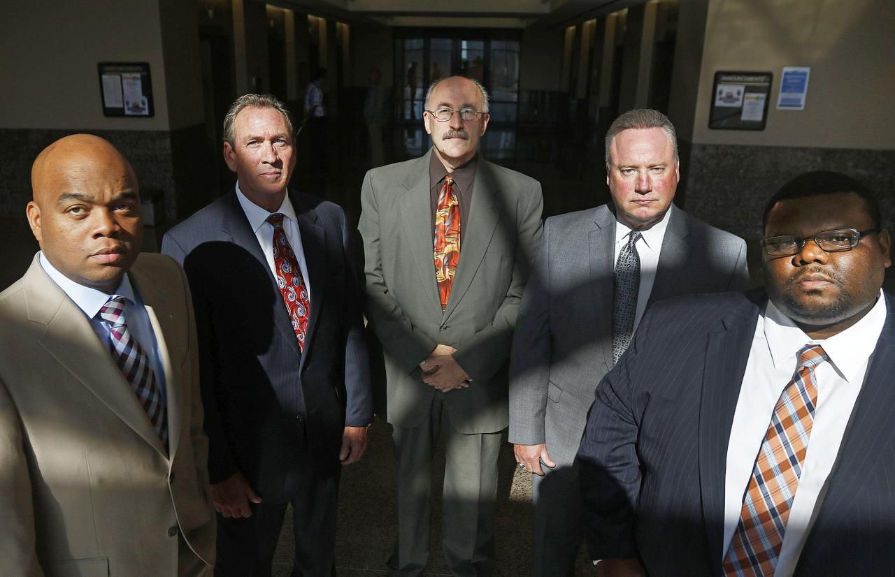 From left: Civil rights chief prosecutor Don Guidry, Felony Investigations' James Hallum, chief investigator Randall Johnson, civil rights investigator Tommy LeNoir and Public Integrity Division chief Jerry Varney are on the job with the Dallas County district attorney's new civil rights unit.