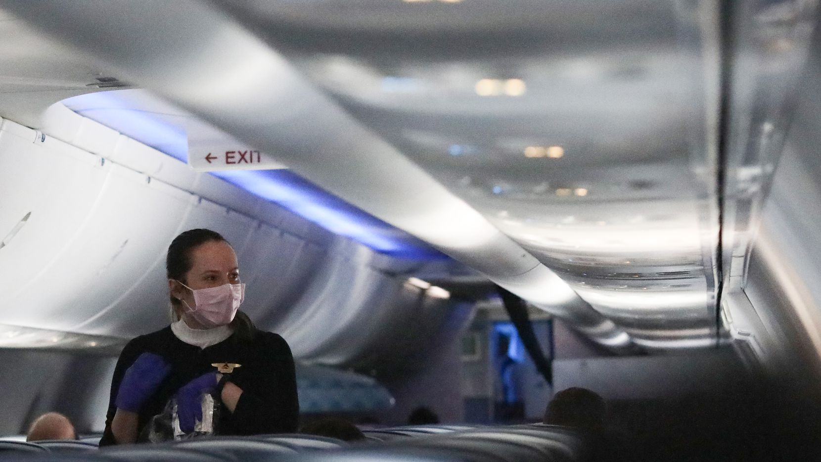 On April 20, a Delta flight attendant served a snack on a nearly empty flight from Baltimore to Atlanta. A majority of Texans aren't going to travel again by air until at least August because of the coronavirus outbreak, though half of those between 18 and 24 years old say they'll fly by July 30, a new Dallas Morning News-University of Texas at Tyler poll found.
