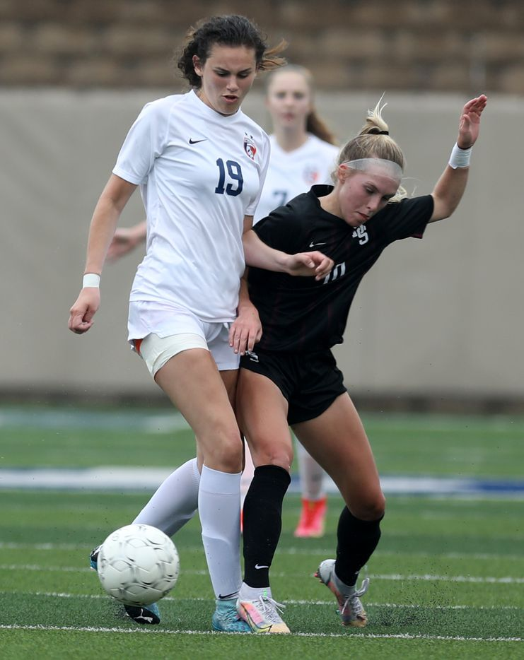 Wakeland's Faith Bell (19) and Dripping Springs' Riley Sisson (10) struggle for control of the ball during their UIL 5A girls State championship soccer game at Birkelbach Field on April 16, 2021 in Georgetown, Texas.  (Thao Nguyen/Special Contributor)