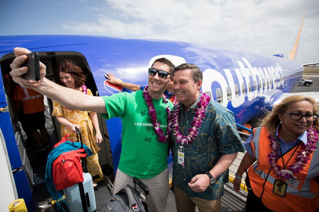 Southwest Airlines President Tom Nealon (2nd from right) greets arriving passengers on the inaugural flight to Hawaii touches down in Daniel K. Inouye International Airport in Honolulu, Hawaii, on Sunday March 17, 2019.