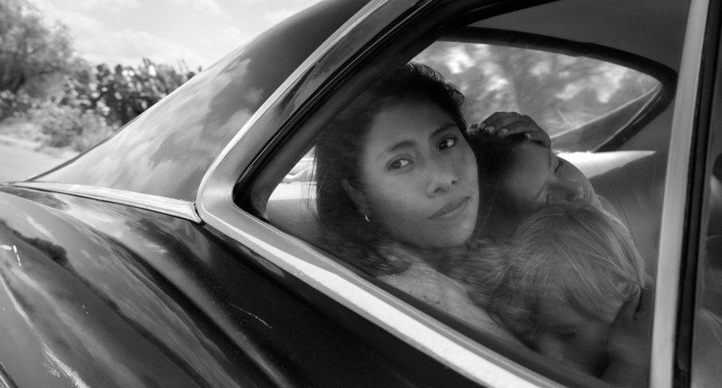"Yalitza Aparicio as Cleo, Marco Graf as Pepe, and Daniela Demesa as Sofi in ""Roma."""