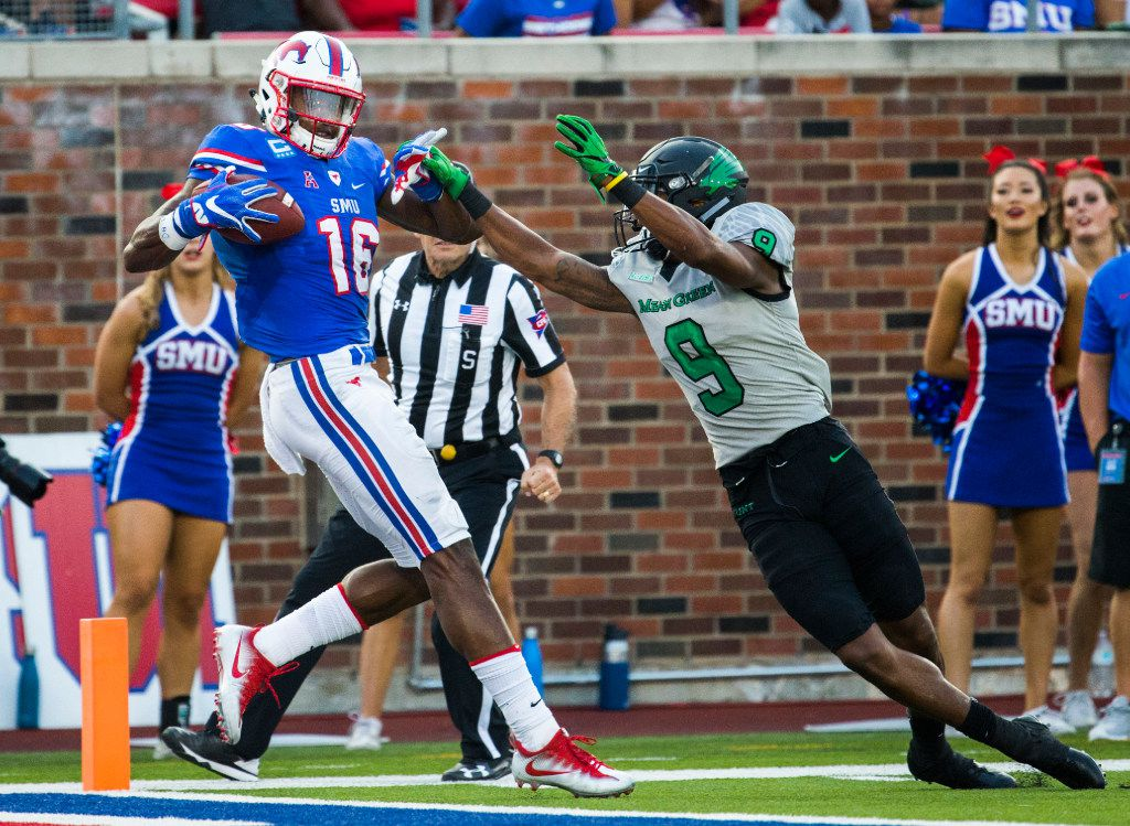 Southern Methodist Mustangs wide receiver Courtland Sutton (16) catches a pass ahead of North Texas Mean Green defensive back Nate Brooks (9) just before he falls to the end zone for a touchdown during the second quarter of a football game between UNT and SMU on Saturday, September 9, 2017 at SMU's Ford Stadium in Dallas. (Ashley Landis/The Dallas Morning News)