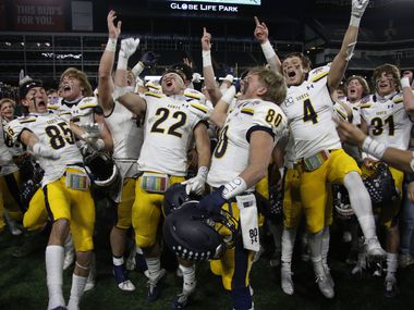 Highland Park Scots players celebrate with great intensity following their 30-20 victory over Frisco Lone Star to advance. The two teams played their Class 5A Division l Region ll semifinal football playoff game held at Globe Life Park in Arlington on December 24, 2020.