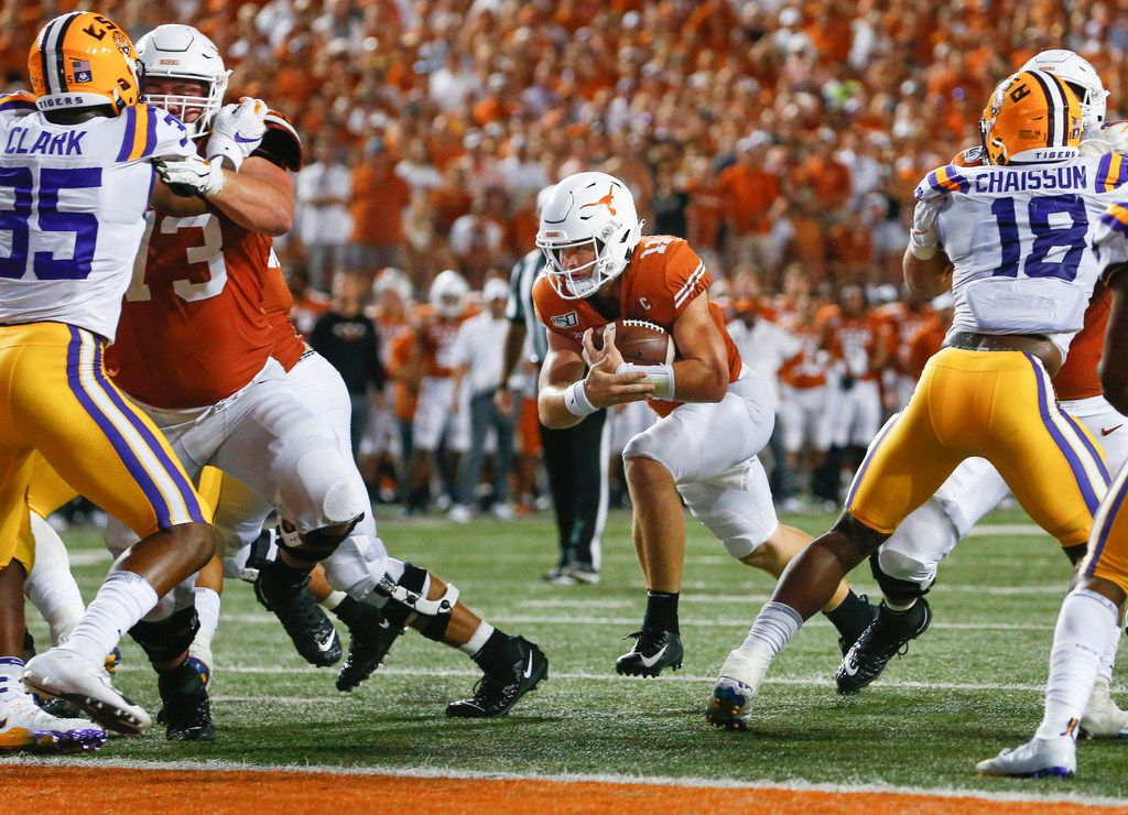 FILE - Texas quarterback Sam Ehlinger (11) runs for a touchdown in the third quarter of a game against LSU on Saturday, Sept. 7, 2019, at Darrell Royal Memorial Stadium in Austin.