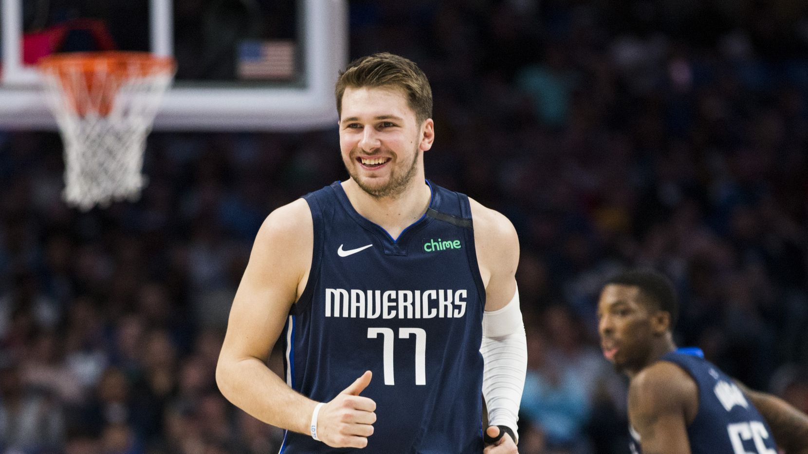 FILE - Mavericks guard Luka Doncic (77) smiles during the first quarter of a game against the Indiana Pacers on Sunday, March 8, 2020, at American Airlines Center in Dallas.