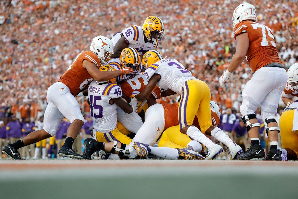 AUSTIN, TX - SEPTEMBER 07:  Keaontay Ingram #26 of the Texas Longhorns is stopped short of the goal line by the LSU Tigers defense in the firt quarter at Darrell K Royal-Texas Memorial Stadium on September 7, 2019 in Austin, Texas.  (Photo by Tim Warner/Getty Images)