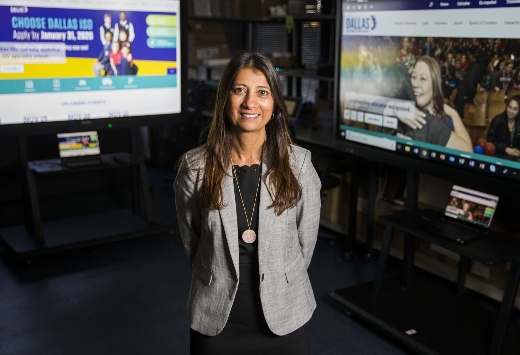 Mita Havlick, new director of the Dallas Education Foundation, poses for a portrait with large interactive touch displays at DISD headquarters Monday. The displays, along with thousands of computers, will go to classrooms damaged by last month's tornadoes.