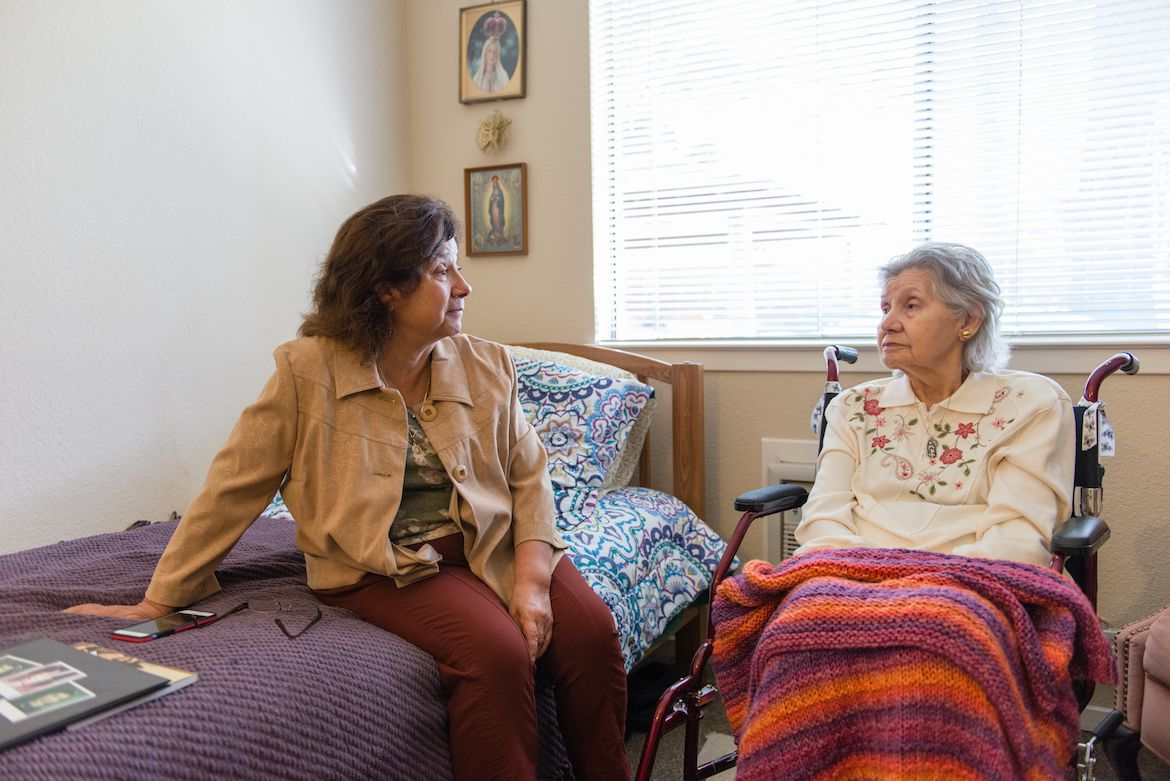 Barbara Marquez visits her mother Florence Marquez at her nursing home, Sagebrook Senior Living, in Carmichael, Calif., in December 2016. Barbara was her mother's primary caregiver until the family decided to put their mother in a 24-hour care facility. (Heidi de Marco/KHN)