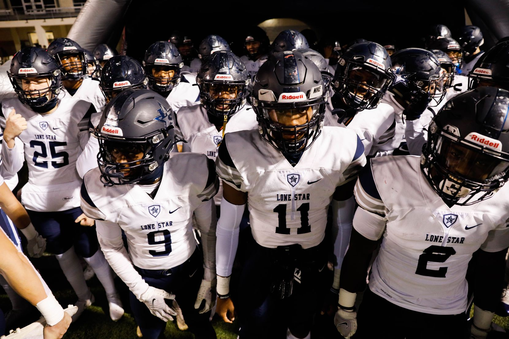 Frisco Lone Star players get ready before the start of a football game against Denton Ryan at the C.H. Collins Complex in Denton on Thursday, Dec. 4, 2020. The game is tied at halftime, 14-14. (Juan Figueroa/ The Dallas Morning News)