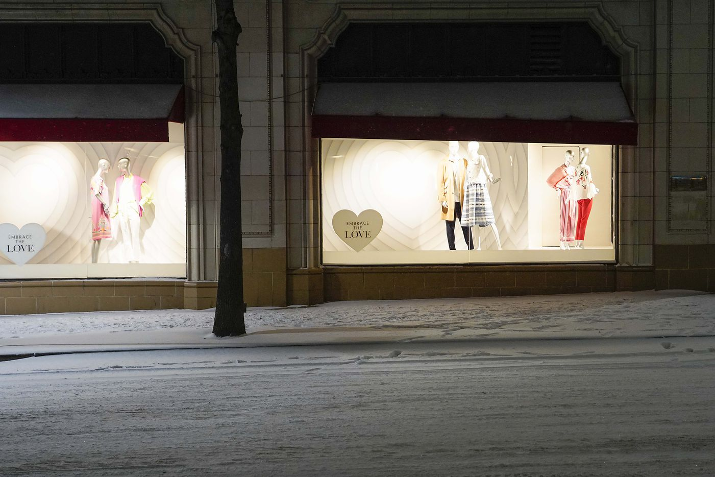Valentines Day themed windows at the Neiman Marcus flagship store downtown are framed by snowy streets as a winter storm brings snow and freezing temperatures to North Texas on Sunday, Feb. 14, 2021, in Dallas.
