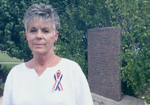 Kelley Fitzwater in 2001, in Killeen, Texas, near the memorial dedicated to those killed in the Luby's Cafeteria massacre. On Oct. 16, 1991, she survived the shootings along with her husband when she pressed herself to the floor in the cafeteria serving line.
