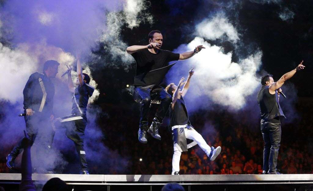 New Kids on the Block member Donnie Wahlberg jumps on the stage as  Jonathan Knight, Jordan Knight, Joey McIntyre, and Danny Wood dance during a performance at American Airlines Center in Dallas, on Thursday, May 14, 2015.