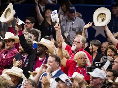 Texas delegates celebrate after the California delegation put Donald Trump over the top for the nomination at the Republican National Convention on July 19, 2016, in Cleveland.