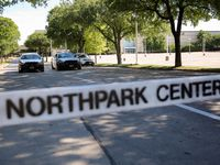 Police officers guard the Park Lane entrance to NorthPark shopping center after reports of a possible protest last weekend.