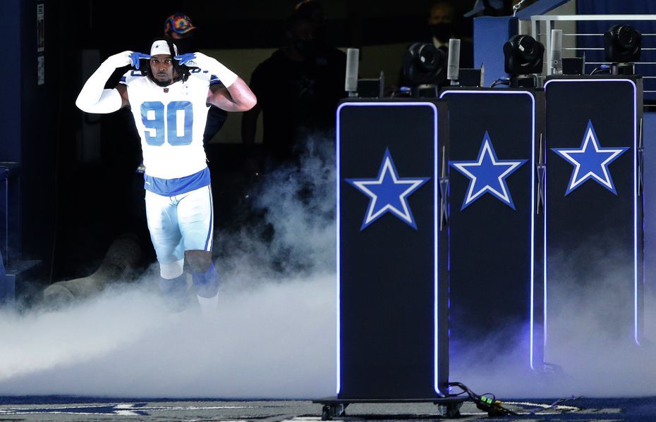 FILE - Cowboys defensive end DeMarcus Lawrence (90) is introduced before a game against the Browns on Sunday, Oct. 4, 2020, at AT&T Stadium in Arlington.