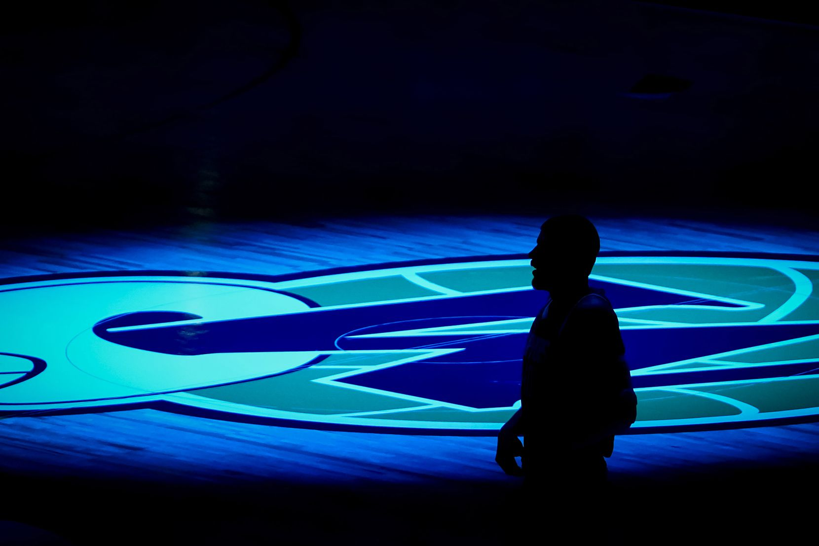 LA Clippers center Ivica Zubac is silhouetted against the Dallas Mavericks logo before an NBA basketball game at American Airlines Center on Wednesday, March 17, 2021, in Dallas.