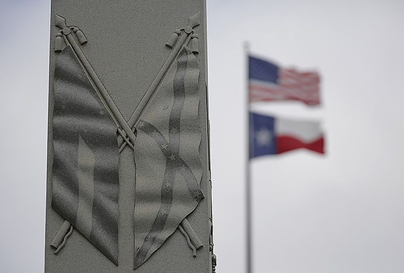 The Confederate flag is seen on a monument to Hood's Texas Brigade at the Texas State Capitol. The Charleston, S.C., massacre last year kick-started a discussion over Confederate iconography.