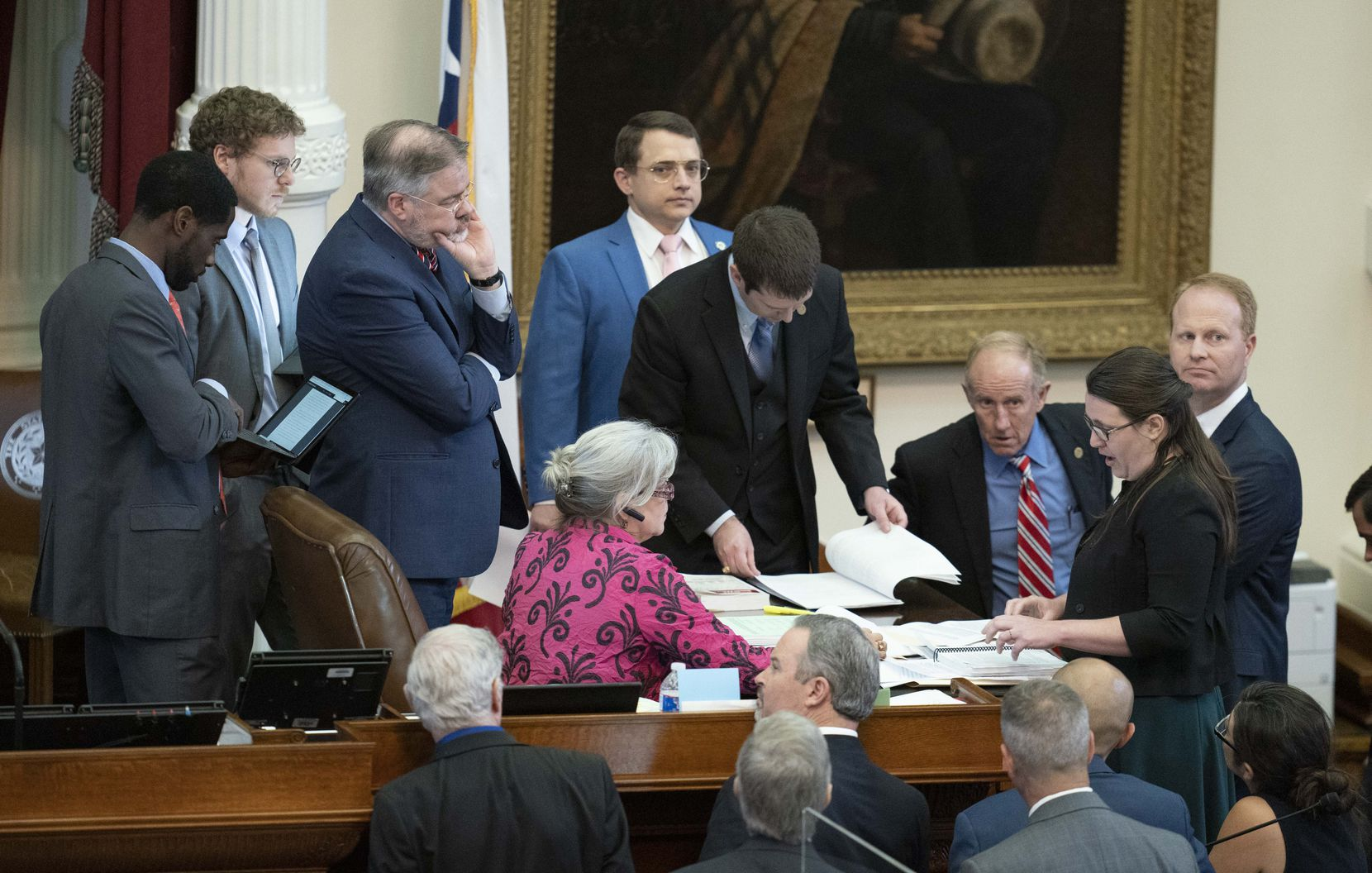 As State Rep. Briscoe Cain R-Deer Park, watches (in blue jacket), House members discuss a point of order on HR 2007, the out-of-bounds resolution on SB 7 on Sunday evening in the Texas House. Cain is chair of the House Elections Committee.  (Bob Daemmrich/CapitolPressPhoto)