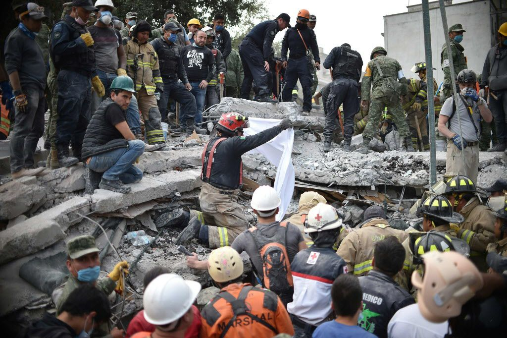 Rescuers, firefighters, policemen, soldiers and volunteers searched for survivors in Mexico City on Wednesday, the day after a strong quake hit central Mexico. (Yuri Cortez/Agence France-Presse)
