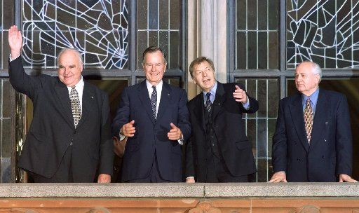 Former U.S. President George Bush is flanked by former German Chancellor Helmut Kohl, left, Berlin Mayor Eberhard Diepgen, second from right, and former Soviet leader Mikhail Gorbachev, right, as they appear on the balcony of Berlin's town hall before Bush was awarded an honorary citizenship of Berlin on Monday, November 8, 1999.